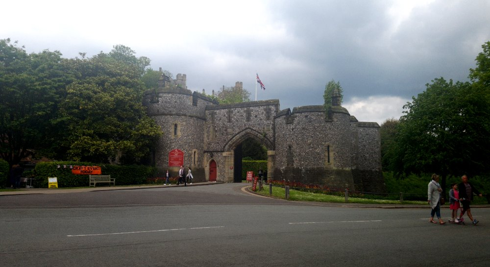 castle entrance flanked by trees