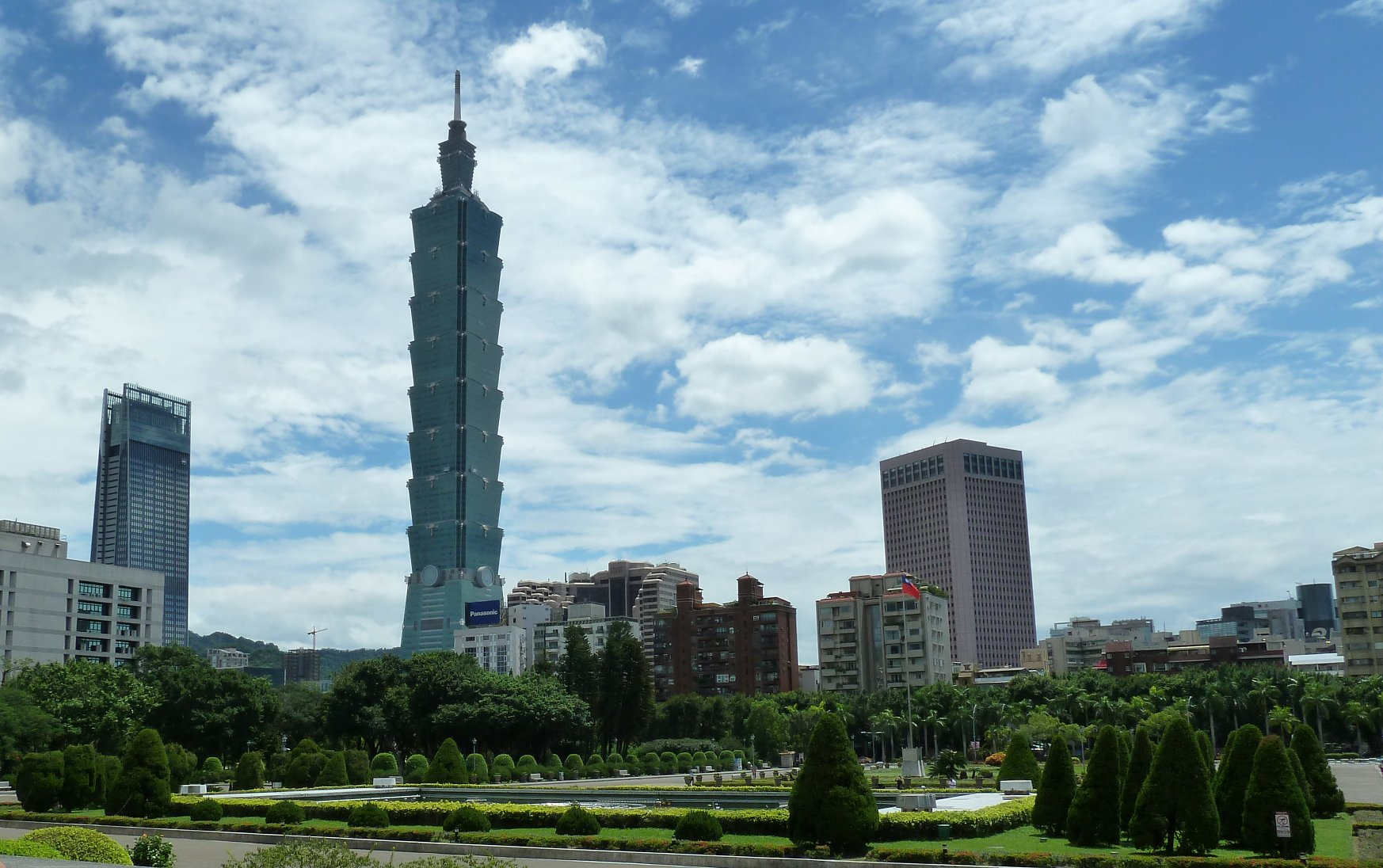 The                                                               Taipei                                                               101                                                               tower                                                               looms                                                               over a                                                               beautiful                                                               garden